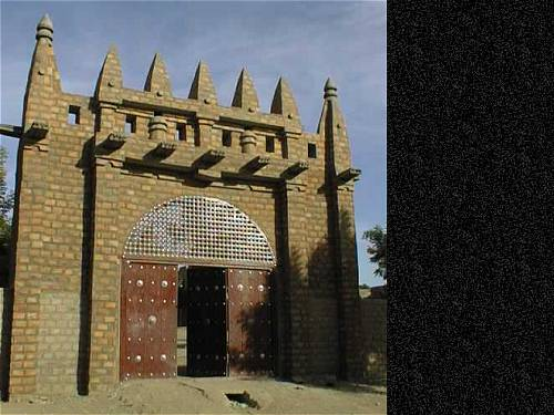 The first picture is of the gate to the Islamic School in the city of D Jenne in the interior of Mali. D Jenne was built in the 9th century on an island in the Niger River Delta.