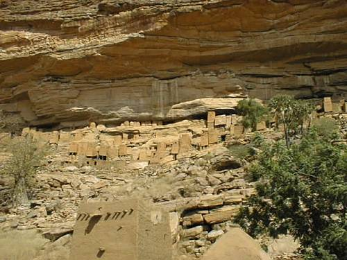 Cliffside dwellings above the village of Teli which have been virtually abandoned for the more prosaic settlements down in the flats. Pictured are not only the homes of the Tellem people, but also the granaries which are still being used to store millet and other supplies as well as the burial caves which are located in the cliff high above all homes.