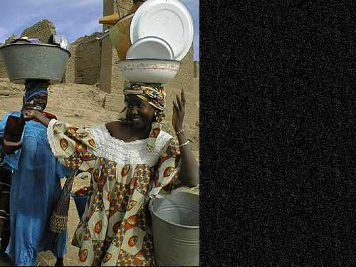 Two Malian women returning from the Bani River where they washed their dishes on the day of the market in D Jenne.