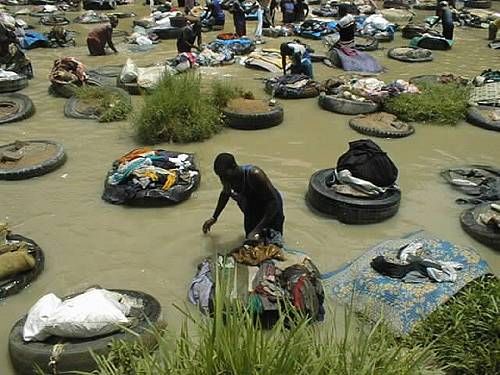 Each launderer must supply his/her own tire which gets permanently secured in his/her section of the river. The washing is done on this tire against the stones which are secured in the centerof the tire. The launderers only have two days off a year.